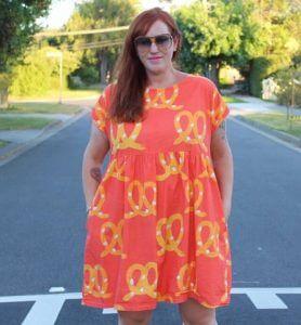 Jen in Kablooie red pretzels dress